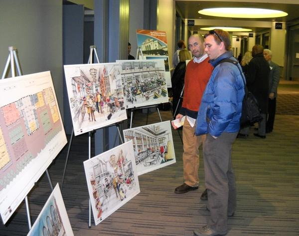 Jeff Tejral, 38, left, and Patrick Picard, 28, both of Denver, look at renderings of plans for Denver Union Station at the Convention Center on Thursday, Nov. 3, 2011.