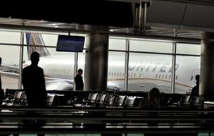 A United Airlines Boeing 787 Dreamliner looms through the windows at Denver International Airport.