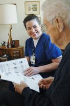 Callie Sawyer, RN, for the Visiting Nurses Association, goes over diet guidelines with patient Wesley Fuller who is now discharged after being diagnosed with congestive heart failure.