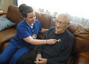 Callie Sawyer, RN, for the Visiting Nurses Association, works with Wesley Fuller who is now discharged after being diagnosed with congestive heart failure.