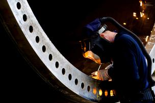 A welder at work at Vestas' Pueblo towers plant.