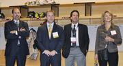 James Mansfield, Cushman & Wakefield Colorado Inc.; Marc Rosenberg, Bank of America; Bruce Alexander, Vectra Bank; and  Larissa Herda, TW Telecom, get a tour of the Avalanche locker room at the DBJ's Connections 2011-2012 event at the Pepsi Center.