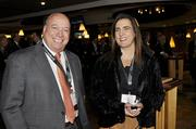 John Arigoni, president and CEO of Boys And Girls Clubs Of Metro Denver Inc., and Katrina Salem, market managing partner at PWC, chat at the VIP reception at the DBJ's Connections 2011-2012 event on the club level of the Pepsi Center.