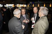 Denver Business Journal Editor Neil Westergaard, center, chats with Jerry Wartgow, UCD; and Gary Mitchell, Anton Collins Mitchell, at the DBJ's Connections 2011-2012 event at the Pepsi Center.