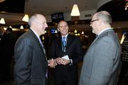 Richard Scharf, president and CEO of Visit Denver; Greg Leonard, Grand Hyatt, and Bruce James, Brownstein Hyatt Farber Schreck, chat at the VIP reception at the DBJ's Connections 2011-2012 event on the club level of the Pepsi Center.
