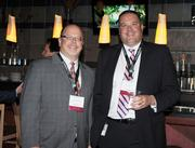 Bruce James, Brownstein Hyatt Farber Schreck, and Tom Spilman, Key Bank, at the DBJ's Connections 2011-2012 event at the Pepsi Center.