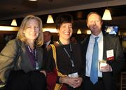 Kim Day, Denver International Airport, Kelly Brough, Metro Denver EDC, and Fred Baumann; Rothberger Johnson and Lyons, at the DBJ's Connections 2011-2012 event on the floor of the Pepsi Center.