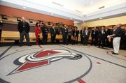 VIP guests get a tour of the Avalanche locker room during the DBJ's Connections 2011-2012 event at the Pepsi Center.