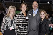 From left, Gretchen Guerra, St. Anthony's Foundation; Margaret Kelly, Remax; DBJ sales rep, Brad Segura; and Leslie Strate, St. Anthony's Foundation; at the DBJ's Connections 2011-2012 event on the floor of the Pepsi Center.