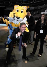 Mitch Thomas, Ashford University, with Denver Nuggets mascot, Rocky, at the DBJ's Connections 2011-2012 event on the floor of the Pepsi Center.