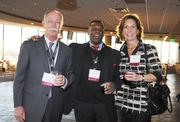 Greg Peay, Bradsby Group; Rich Jennings, Comcast; and Margaret Kelly, Remax; gather at the VIP reception at the DBJ's Connections 2011-2012 event on the club level of the Pepsi Center.