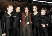 Rachel Hesterman, DBJ advertising coordinator, (center) with members of the Rocky Mountain Silhouettes at the Connections 2011-2012 event on the floor of the Pepsi Center.