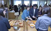 """Connie Purdy, legal secretary at Wheeler Trigg O'Donnell, enjoys a """"flash party"""" for employees. These are spur-of-the-moment celebrations announced via email at the moment they happen."""