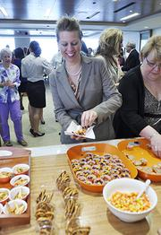 """Jenny Pointer, legal secretary at Wheeler Trigg O'Donnell, enjoys a """"flash party"""" for employees. These are spur-of-the-moment celebrations announced via email at the moment they happen."""