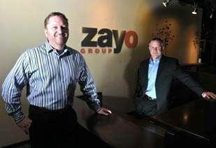 Dan Caruso, president and CEO, and Ken desGarennes, CFO of Zayo Group.