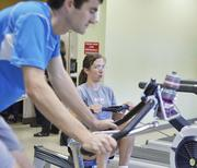 Amgen ranked No. 1 in the large-size business category. Susan Francis and Kevin Tolley work out at Plus One Health Management, Amgym Fitness Center, at Amgen in Longmont. The onsite fitness center has five staff memebers to provide Amgen employees with multiple fitness opportunities.