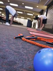 Bridgepoint Education Inc. ranked No. 3 in the x-large-size business category. Bridgepoint offers free fitness classes for their employees. Claire Holton-Zenner takes part with trainer, Robert Tanaka.
