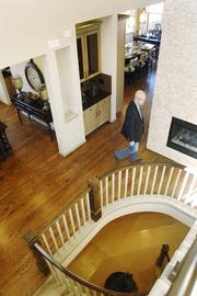 Rod Mickelberry, regional president of Cardel Homes, walks through a model home at Solterra in Lakewood.