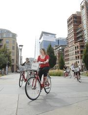 Davita ranked No. 1 in the x-large-size business category. A group of DaVita employees head out on a bike ride using Denver B-cycles. The company's Village Vitality wellness program lends many supportive services to employees who want to make a change in their lives.