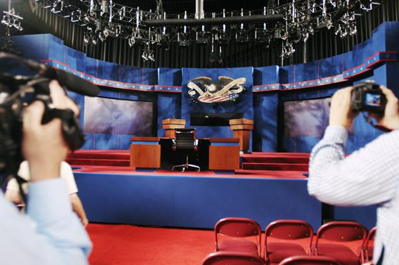 The press takes pictures during a walk-through Tuesday to view the stage set for the presidential debate Wednesday night at the University of Denver's Ritchie Center.