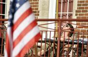 Sam Beattie, a sophomore at DU and a Kappa Sigma fraternity member, soaks up the sun the day before the presidential debate. Preparations were being made on campus for Wednesday night's event at the Ritchie Center.