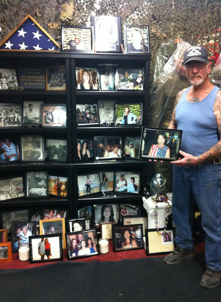 Mel Bernstein holds a photo of his wife that's part of a memorial he erected in her memory at his military museum in Colorado Springs.