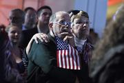 Frank and Elizabeth Detschdermitsch watch early results of Romney's campaign.