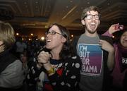 Annette Bowman and Jefferson Campbell celebrate Obama's win.