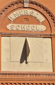 A sundial graces the front of the Emerson School at 1420 Ogden Street. Preserving the historic nature of the school is a factor when refurbishing.