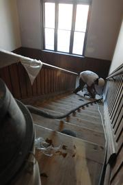 The stairs at the Emerson School at 1420 Ogden Street are refinished. Preserving the historic nature of the school is a factor when refurbishing.