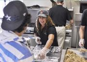 Tammie Waddell, marketing manager at Fireside Production, serves breakfast at Urban Peak.