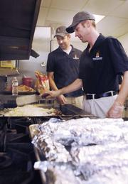 Everett McEwan, right, videographer and editor and Tom McDonald, director of production and partner from Fireside Production, cook hashbrowns to serve at Urban Peak. The food was purchased, cooked and served by Fireside Production.