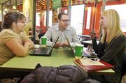 Alon Mor, president and CEO at Garbanzo Mediterranean Grill, (center) works with the marketing team, Cheryl (left) Cassaly and Beth Hardy at the Aurora/Cornerstar location near East Arapahoe Road and South Parker Road.