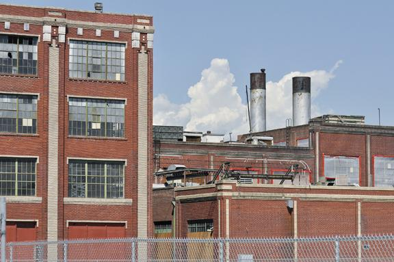 Local company officials at Gates Corp. are pursuing plans to demolish old factory buildings at Broadway and Interstate 25.
