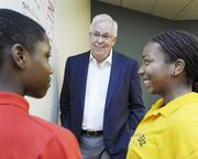 David Palmer, managing shareholder at Greenberg Traurig, works with young people at YouthBiz, one of the many programs the company supports.