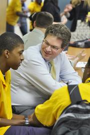 Neil Oberfeld, shareholder at Greenberg Traurig, works with kids at YouthBiz.