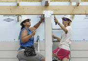 Volunteers work on a Habitat for Humanity Women Build project — a two-story duplex near Sloans Lake. The work requires about 20 volunteers a day. More than 600 women work with Women Build.