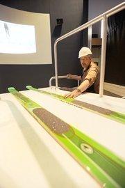 Bill Convery, state historian for History Colorado Center checks the skis on the interactive ski jump explaining Colorado's ski history.
