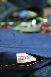 A logo sewn into climbing pants for Hummingbird Mountain Gear.