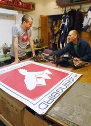 Micah Day, owner of Hummingbird Mountain Gear, works with Nate Butler, pattern maker, in Butler's shop.