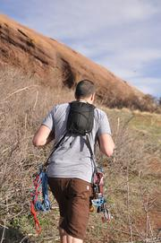 Micah Day, owner of Hummingbird Mountain Gear, tests some of his products on a hike at Red Rocks.