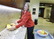 Intrepid Potash Inc. ranked No. 3 in the small-size business category. Kay Galinet, director of first impressions at Intrepid Potash, sets fruit out.