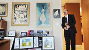 Jack Tanner, attorney at Fairfield and Woods PC, collects animation art that adorns all corners of his office. He says he sometimes spends 11 hours a day in his office and the art makes him smile.