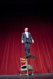 """Josh Davies, CEO of The Center for Work Ethic Development, took to the Paramount Theatre stage to reenact the Robin Williams scene from """"Dead Poet's Society."""" (See B6) Forty under 40 winners were invited to bring props to the photo shoot to signify their favorite films."""