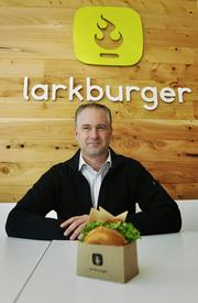 Adam Baker, president of Larkburger at the newest location at 16th and California streets.December 2012