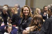 Sen. Morgan Carroll, D-Aurora, watches as photos are taken on opening day of the Legislature.