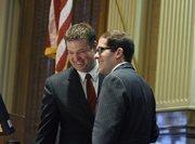 Rep. Frank McNulty hands off the House speaker duties to Rep. Mark Ferrandino on opening day of the Legislature.