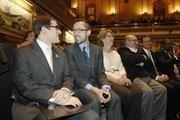 New Speaker of the House Mark Ferrandino sits with his husband, Greg Wertsch, during opening day of the Legislature. Ferrandino's parents, Stephanie and John Ferrandino, are at right.