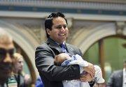 Rep. Daniel Pabon, D-Denver, holds his son, Alec, on opening day of the Legislature.