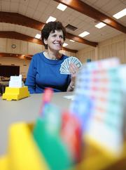 Marion Brum De Barros, senior vice president at UMB Bank, who has played bridge in different countries, says a unique feature of playing the game internationally is that you don't need to know the language of the country you're in. Since bidding boxes use cards to represent player's bids, there's no need to speak to other players.